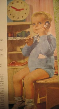 A boy in knitted clothes
