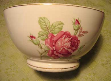 A big bowl with roses on
