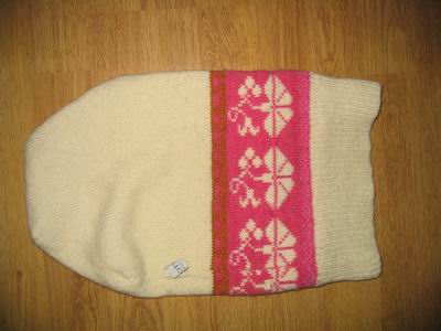 A knitted cap in wool that will be felted