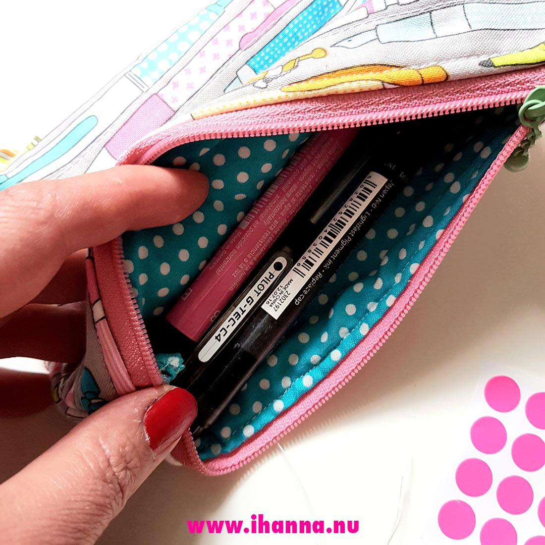 The inside of my pen case made by mom is polka dot says iHanna