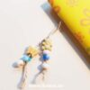 Bead dangle decoration on the yellow doodle book with blank pages | journal 26 in iHanna's Journal release 3 2021